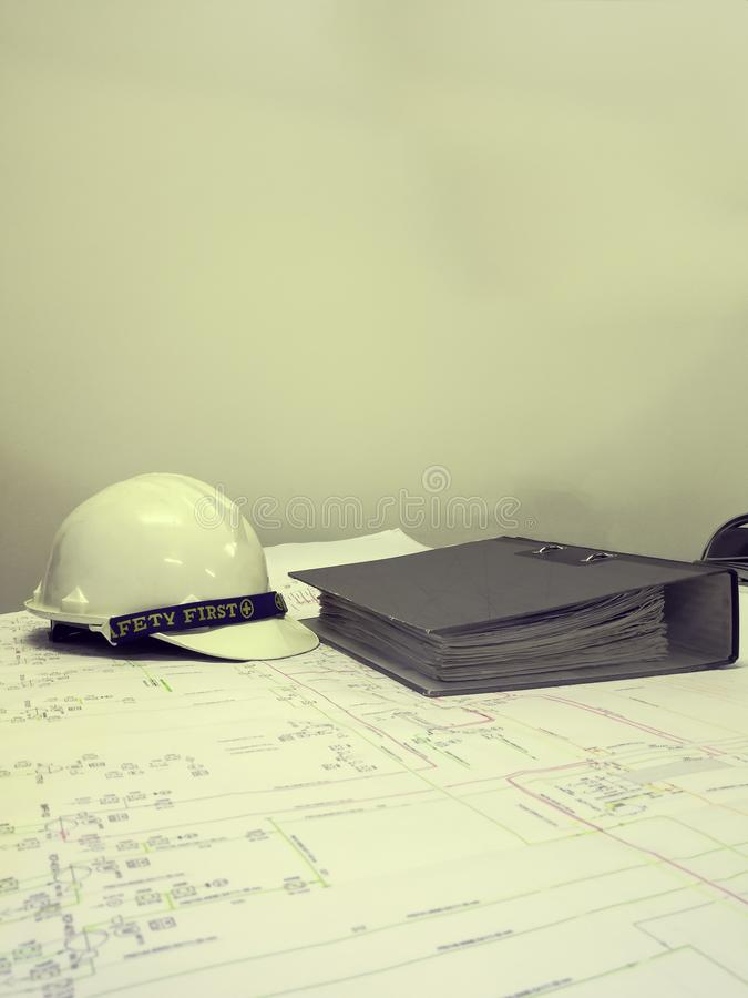 Filter effect color of Industrial blueprint with safety helmet. And office file royalty free stock photo