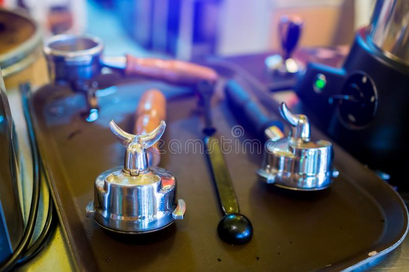 Filter holder and equipment for espresso coffee machine In the brown tray royalty free stock photography