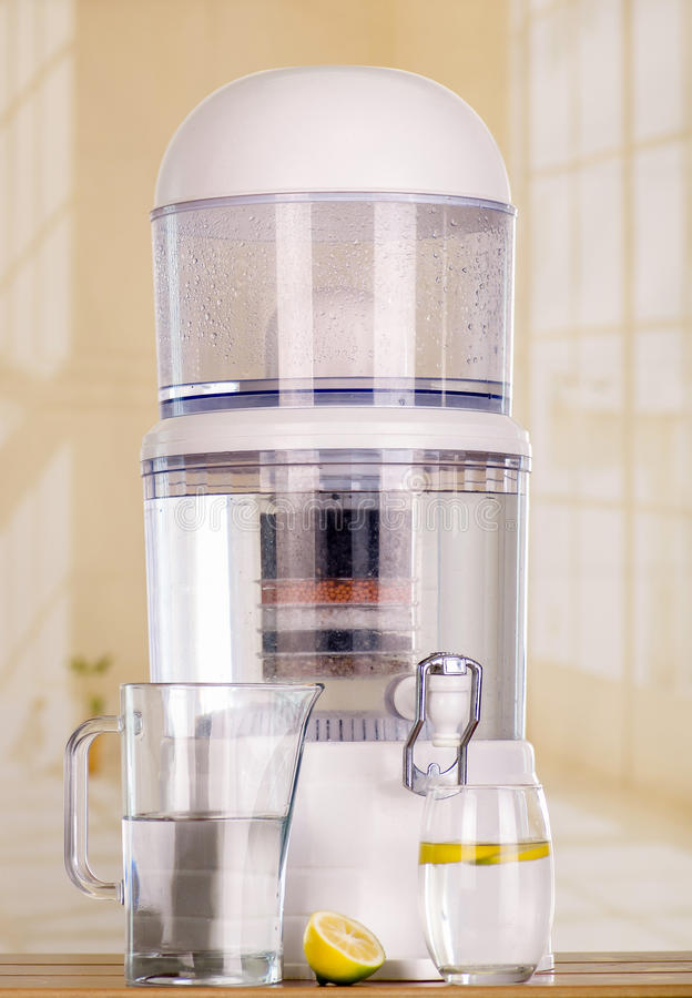 Filter system of water purifier on a kitchen background stock photos