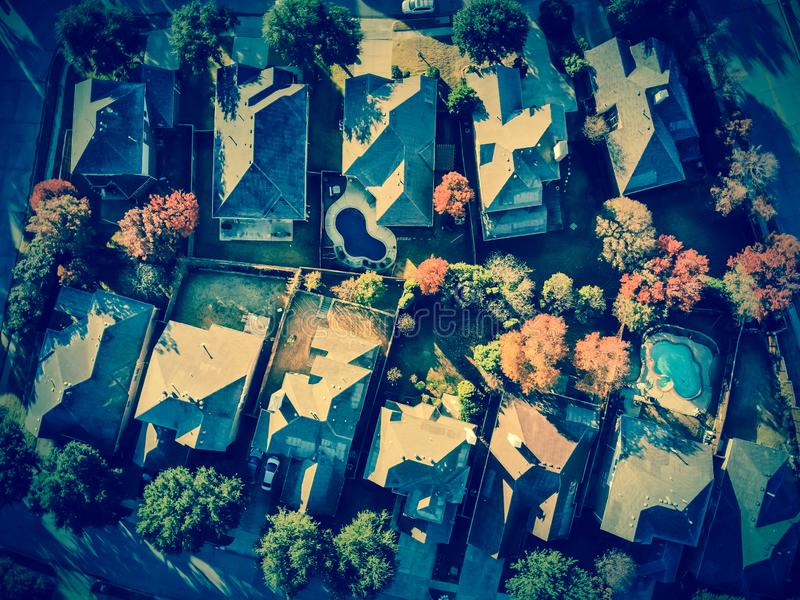 Filtered image aerial view typical house with light snow covered roof in cold fall morning royalty free stock image