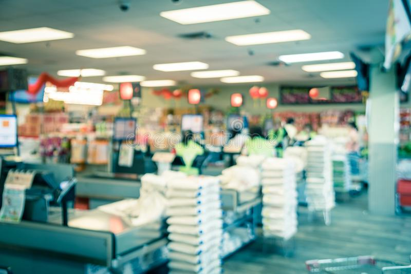Filtered image blurry background checkout counter at Asian supermarket in USA stock photography