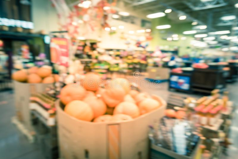 Filtered image blurry background festive Halloween decoration at supermarket in Houston royalty free stock images