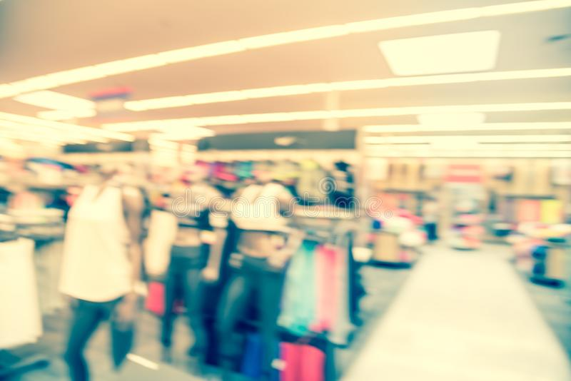 Filtered image blurry background mannequins at American sport and fitness clothing store stock photo