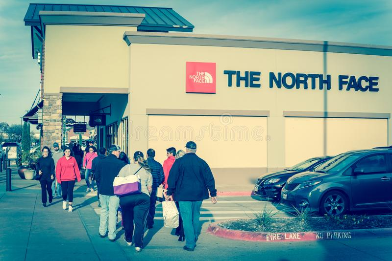Filtered image customers walking by The North Face store at outlet shopping in Texas, America stock image