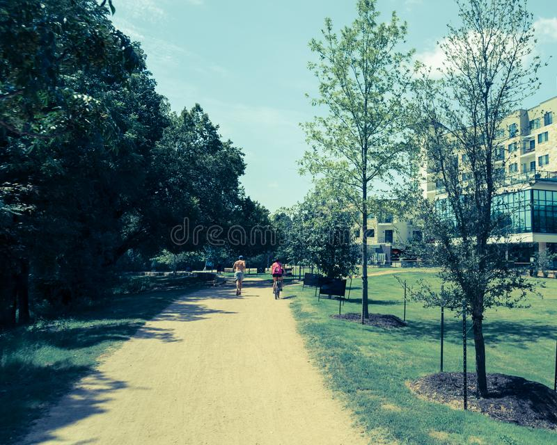 Filtered image healthy people running and biking on natural trail royalty free stock photos