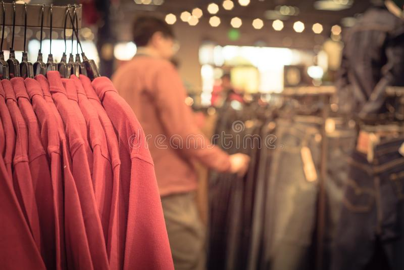 Filtered image shallow dof image clothes hanging at clothes store in America royalty free stock images