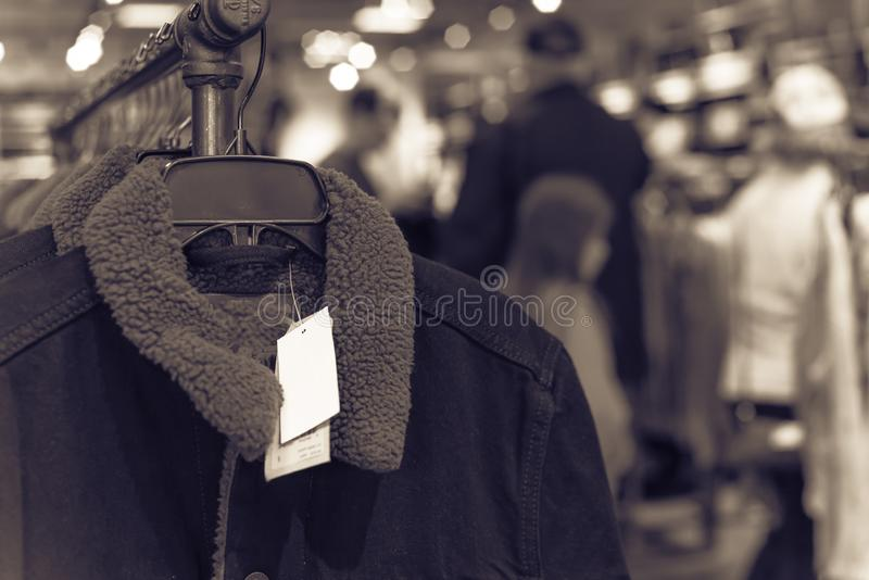 Filtered image shallow dof image clothes hanging at clothes store in America stock image