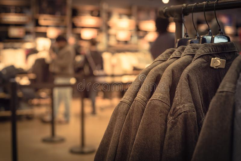 Filtered image shallow dof image clothes hanging at clothes store in America royalty free stock photos