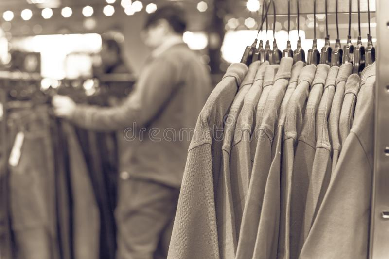 Filtered image shallow dof image clothes hanging at clothes store in America royalty free stock photography
