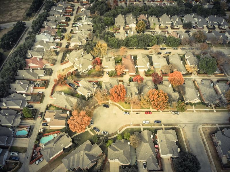 Filtered image top view cul-de-sac street in residential neighborhood with colorful autumn leaves stock photography