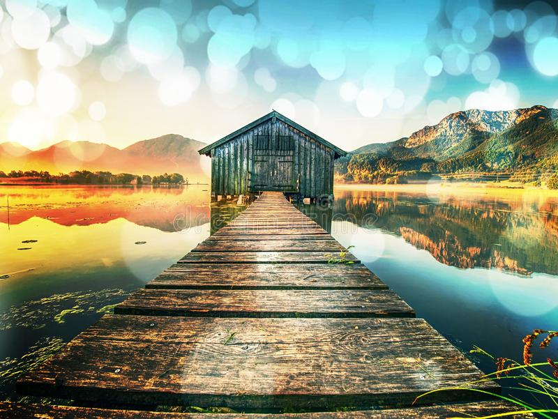 Filtered. Old wooden ship house at scenic Lake. Silent bay royalty free stock photos