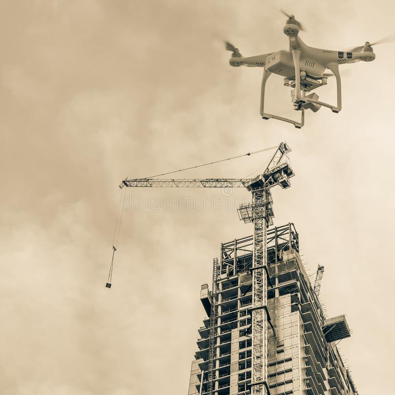 Filtered tone image of drone on construction site working crane stock photos