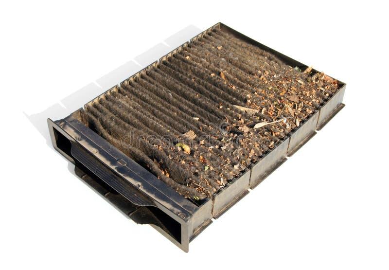 Filtre souillé de carbone d'air de carlingue de voiture photographie stock