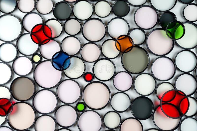 Filtri fotografici di vetro dal giro multicolore di varie dimensioni fotografia stock
