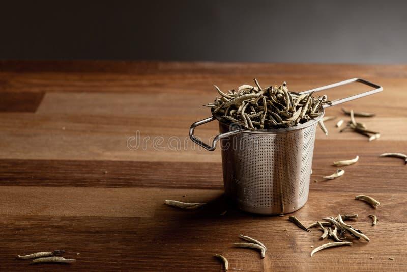 Filtro del tè e tè sciolto fotografia stock