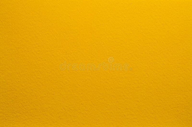 Filtyttersida i gul färg abstrakt bakgrundstextur royaltyfri foto