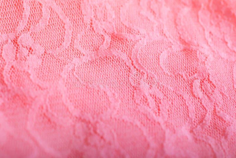Fim acima da textura cor-de-rosa do laço do material de pano foto de stock