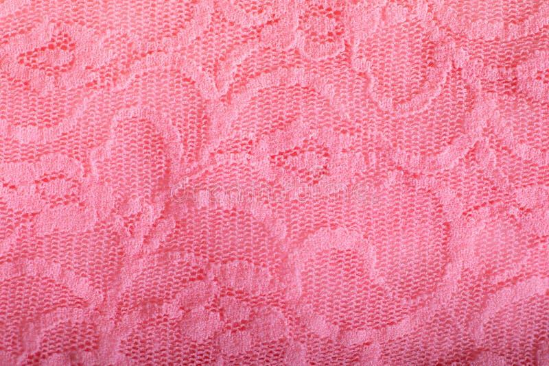Fim acima da textura cor-de-rosa do laço do material de pano fotografia de stock royalty free