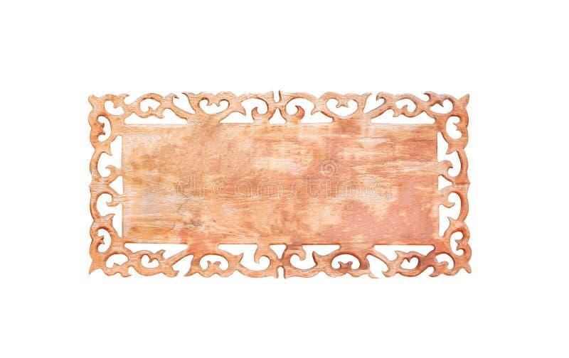Fim acima da textura de madeira velha vazia do sinal com cinzeladura dos testes padrões da borda isolados no fundo branco com tra foto de stock royalty free