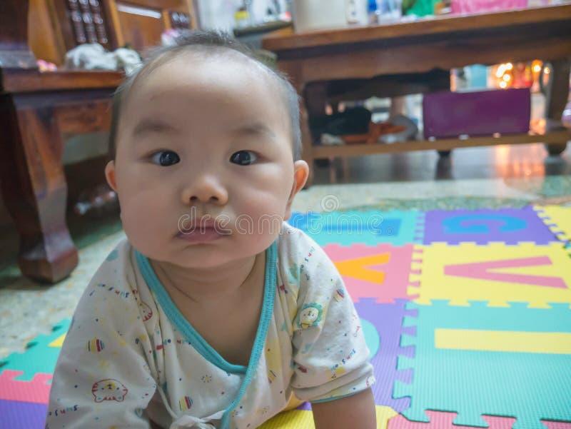 Fim acima do bebê asiático considerável de Cutie foto de stock royalty free