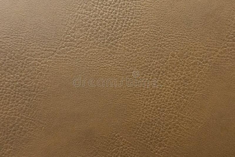Fim acima do contexto de couro do marrom do sofá, textura do fundo fotografia de stock royalty free