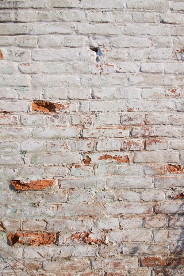 Fim acima do fundo da parede de tijolo, adôbe diferente da forma, textura de superfície gasta velha gasto do sumário áspero verti imagens de stock