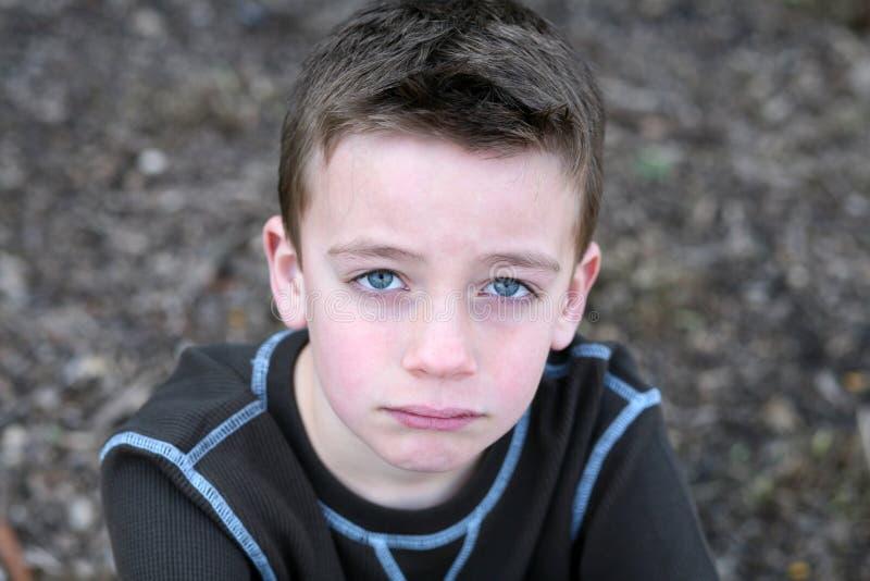 Fim acima do menino bonito com face triste fotografia de stock royalty free