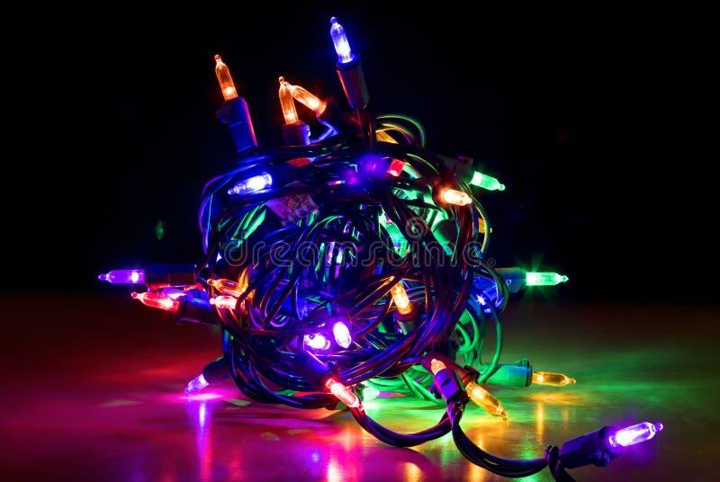 Fim acima do pacote de incandescência colorido de luzes de Natal do diodo emissor de luz fotografia de stock royalty free