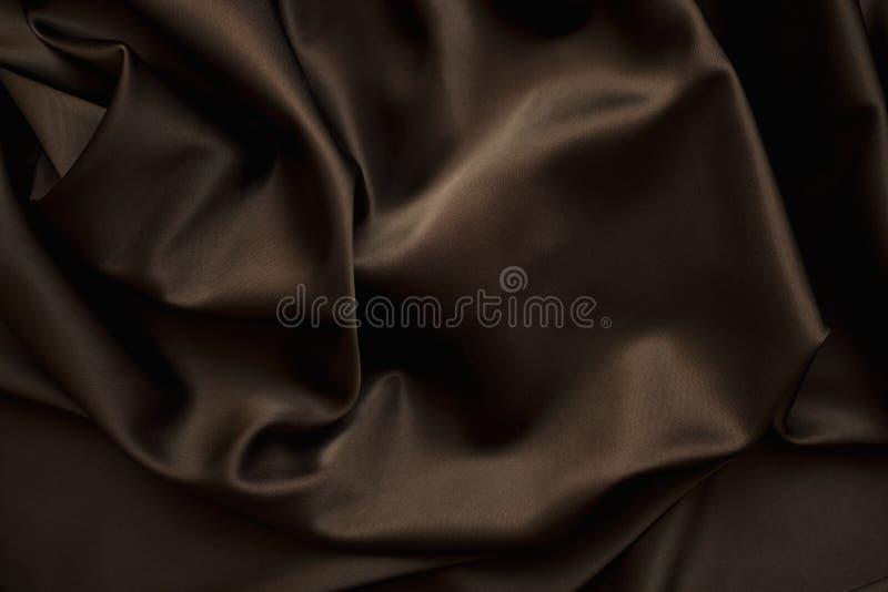 Fim castanho chocolate da seda do cetim de pano acima fotos de stock