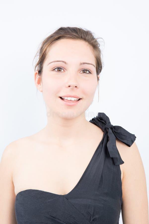 fim da cara da mulher acima do estúdio novo do retrato no cinza foto de stock