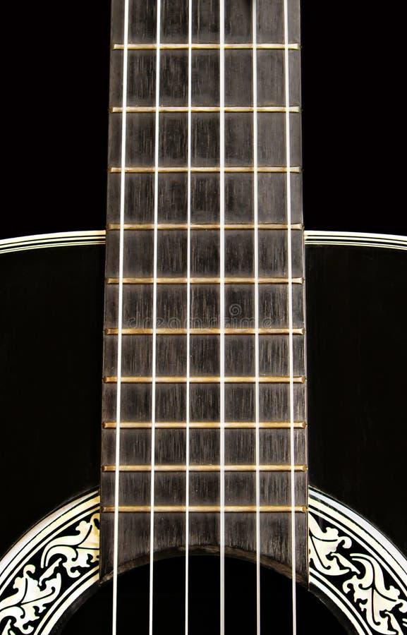 Fim da guitarra acústica acima imagem de stock