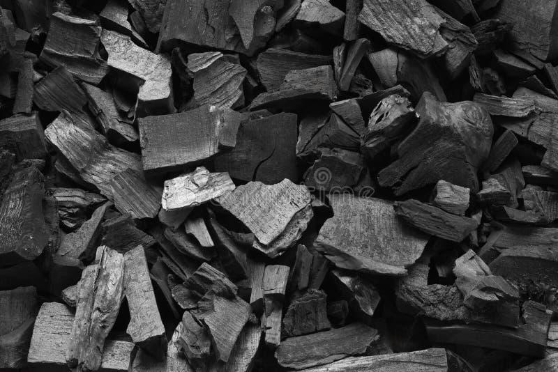 Fim de carvão da grade do assado acima Fundo preto da textura do carvão vegetal fotos de stock royalty free