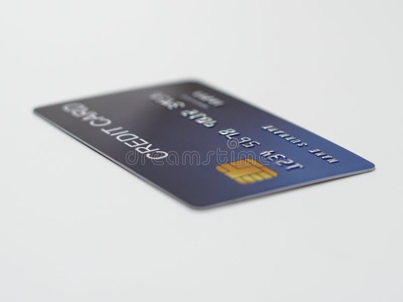 Fim do cartão de crédito acima do tiro com foco seletivo para o fundo fotografia de stock