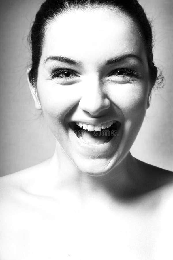 Fim preto e branco acima de uma mulher feliz imagem de stock royalty free
