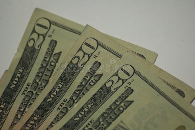Fim velho amarrotado da moeda de papel em notas de dólar do dinheiro vinte fotos de stock