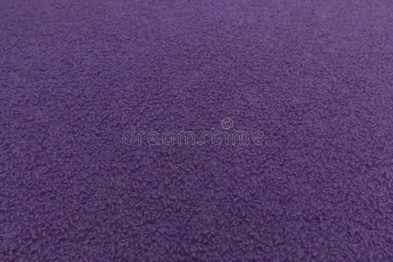 Fim violeta da tela acima com bacground da textura de matéria têxtil ilustração royalty free