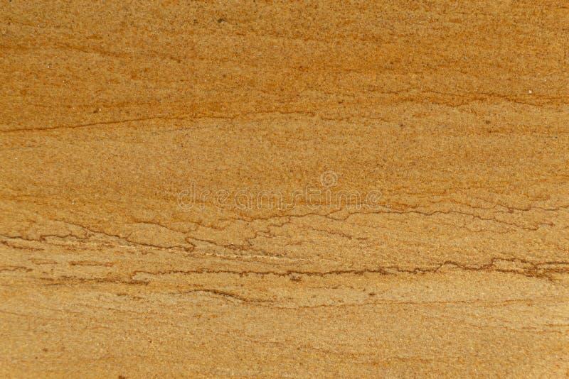 Fin approximative jaune naturelle de texture de pierre de sable vers le haut de fond images stock