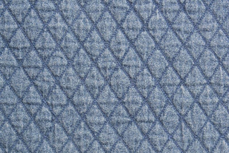 Fin bleue piquée de texture d'élément de tissu de denim de tissu vers le haut de fond photo stock
