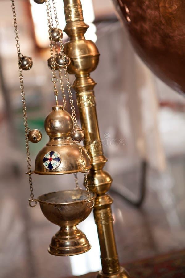 Fin d'une lumière de cuivre de flotteur pour le frankinscence avec des cloches photo libre de droits