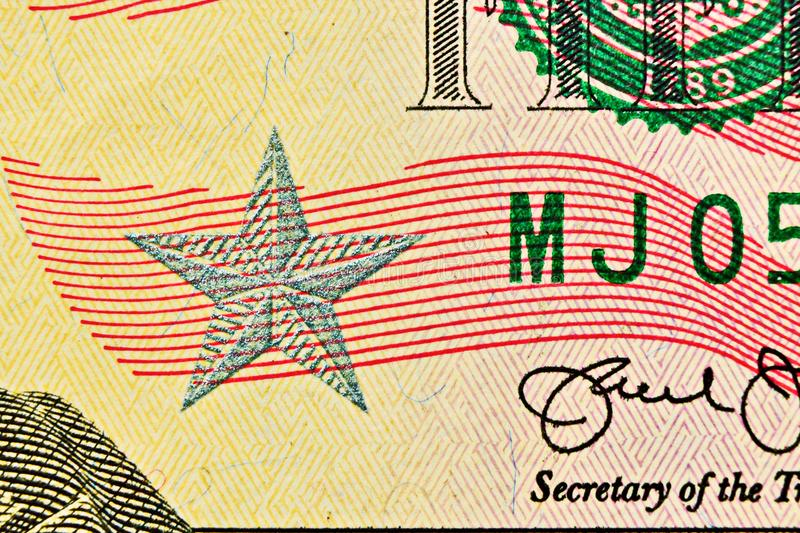 Fin de billet d'un dollar avec l'étoile argentée et la fibre évidente dans le papier photo libre de droits