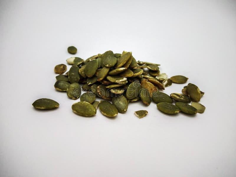 fin de graine de citrouille tirée à un arrière-plan blanc photographie stock libre de droits