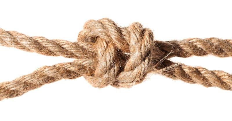 Fin du noeud du braconnier sur la corde épaisse de jute images libres de droits