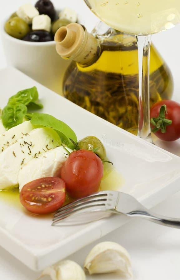 Fin italienne de mozarella de tomate vers le haut photographie stock