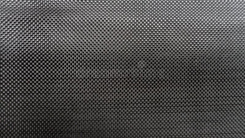 Fin noire tissée de fond de matériau composite de fibre de carbone d'armure toile vers le haut de vue image libre de droits