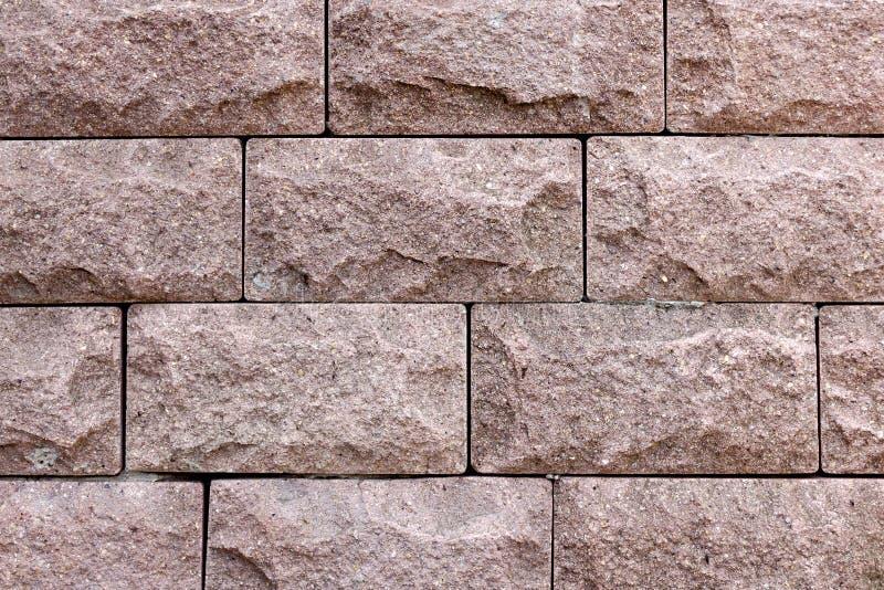 Fin rose sale de couleur de briques de revêtement  Texture en pierre en lambeaux images stock