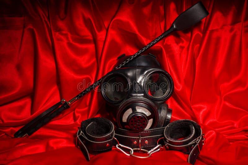 Fin vers le haut d'équipement de bdsm Esclavage, jeux adultes libertins de sexe, repli et concept de mode de vie de BDSM images stock