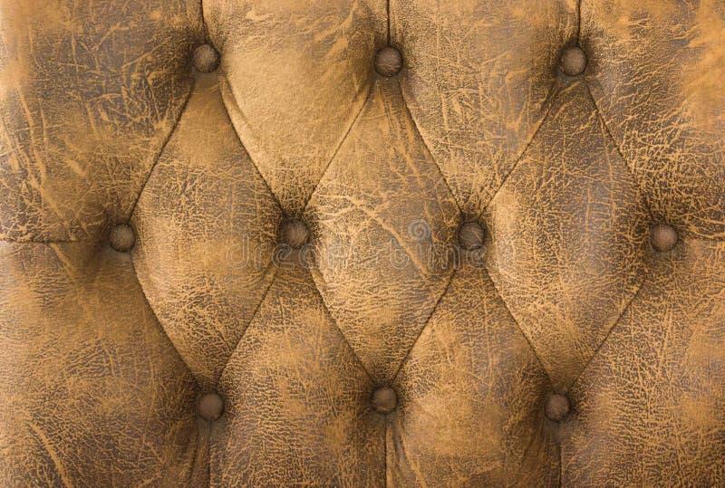 Fin vers le haut de cuir de brun de cru de fond de texture de sofa photos libres de droits