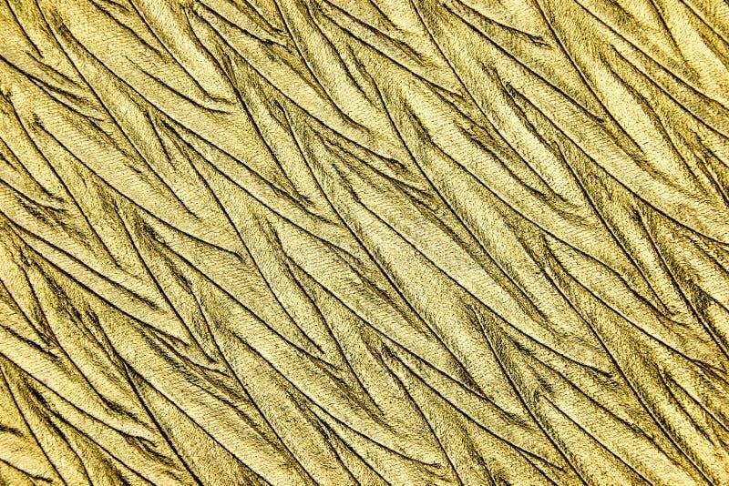 Fin vers le haut de matériel métallique de luxe d'or photo stock