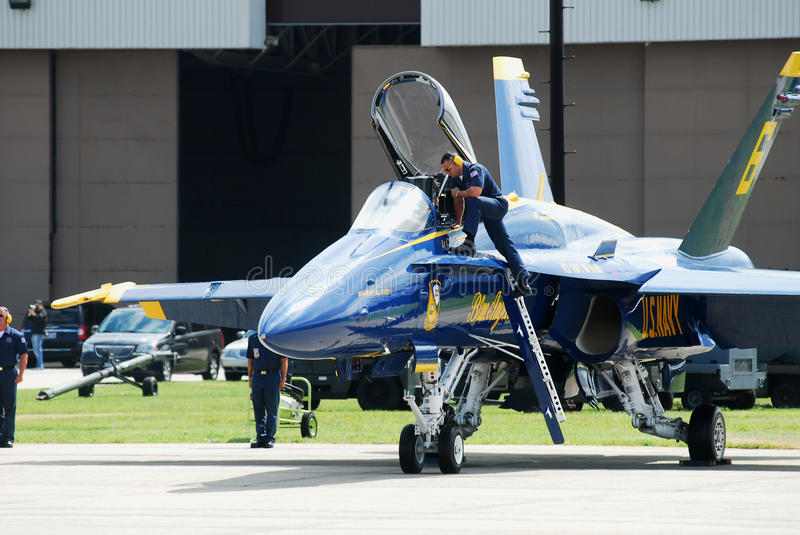 Final check. Member of the United States Navy Blue Angels ground team inspects the cockpit of the number 6 jet prior to performing at the Quonset Airshow in royalty free stock photos