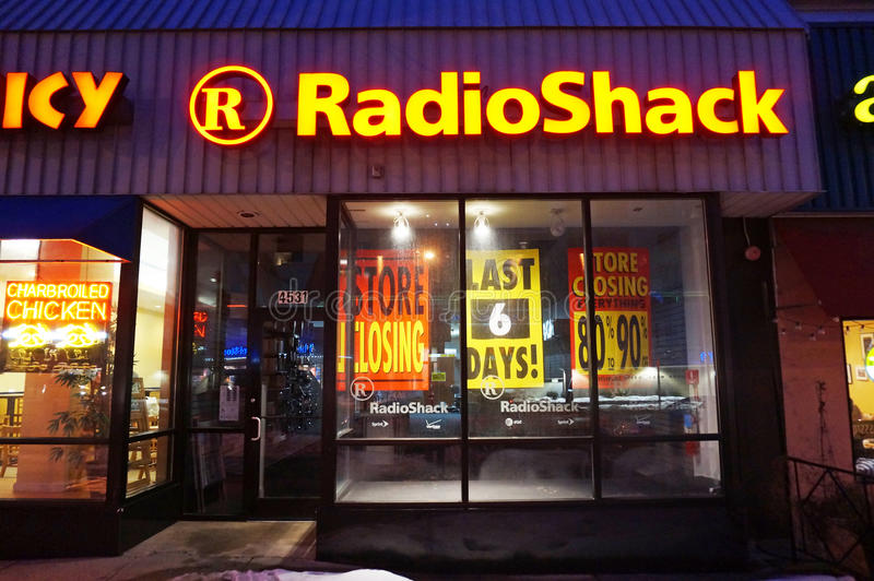 Final Days of Radio Shack. Photo of radio shack store at night on 2/22/15. It will soon close ending its final days. Radio shack filed for chapter 11 bankruptcy stock photos